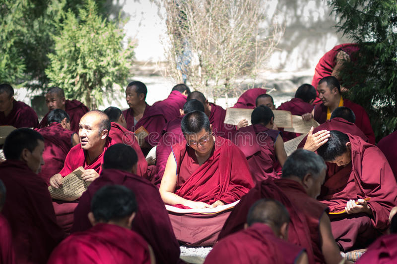 Debating Buddhist scriptures - Lamas at Tibet Sera Monastery. The Sera Monastery in Tibet and its counterpart in Mysore, India are noted for their Monk Debates royalty free stock images