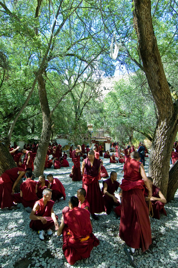 Debating Monks. Tibetan monks at Sera monastery debating in the courtyard stock photos