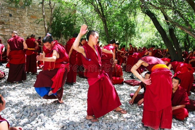 Debating monks. Lama are debating mutually at Sera Monastery, Tibet royalty free stock images