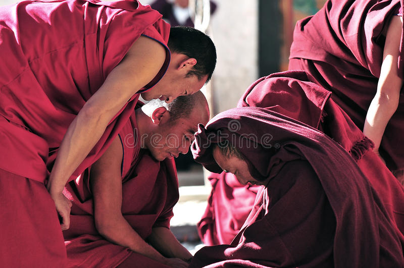 Debating monks in Tibet. Tibetan monks at Sera monastery debating in the courtyard royalty free stock photos