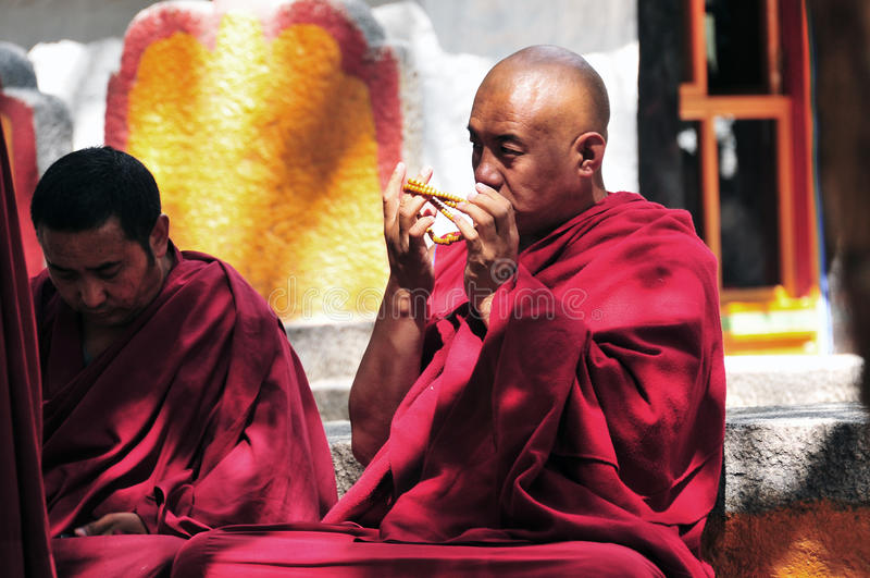 Debating monks in Tibet. Tibetan monks at Sera monastery debating in the courtyard royalty free stock photography