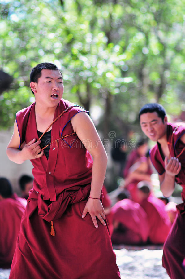 Debating monks in Tibet. Tibetan monks at Sera monastery debating in the courtyard royalty free stock images