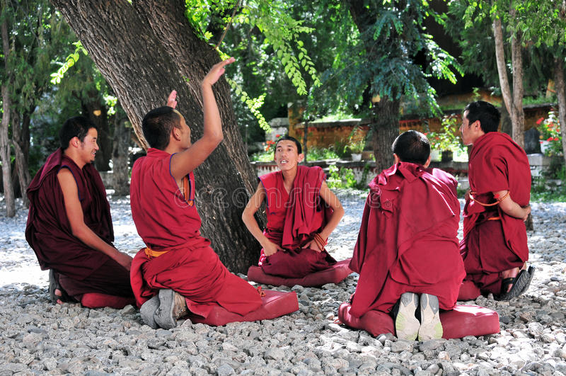 Debating monks in Tibet. Tibetan monks at Sera monastery debating in the courtyard stock photography