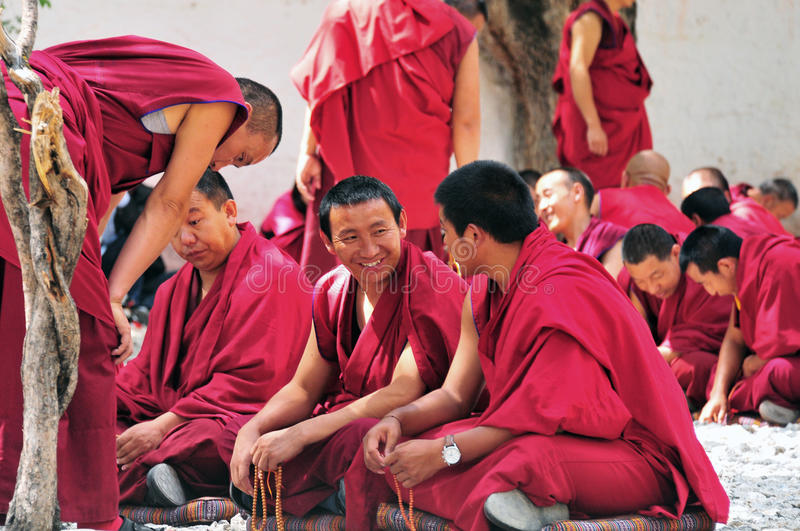 Debating monks in Tibet. Tibetan monks at Sera monastery debating in the courtyard stock photos
