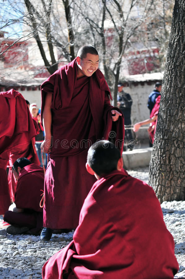 Debating monks in Tibet. Tibetan monks at Sera monastery debating in the courtyard stock image