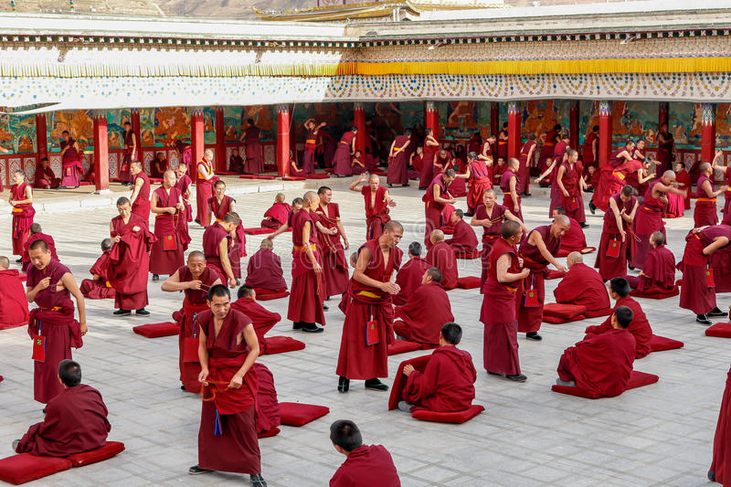Debating Monks. Monks debating at the Tongren buddhist temple in Qinghai, China stock image