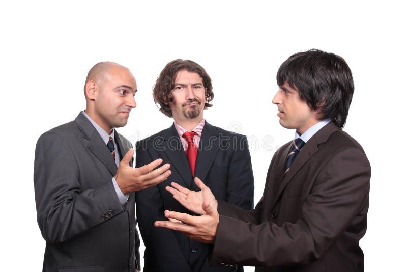 debattera män för affär arkivfoto