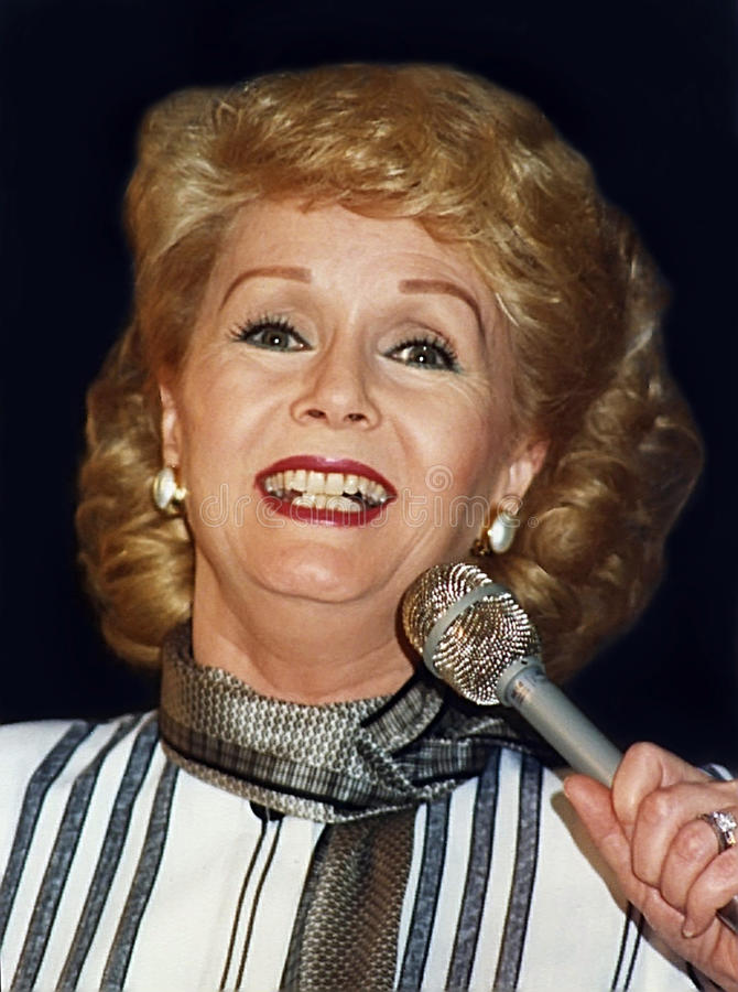 Debbie Reynolds. Is seen here narrating a fashion show at Carson Pirie Scott and Company Store in Chicago, Illinois in March of 1987. Reynolds was an Academy stock photo