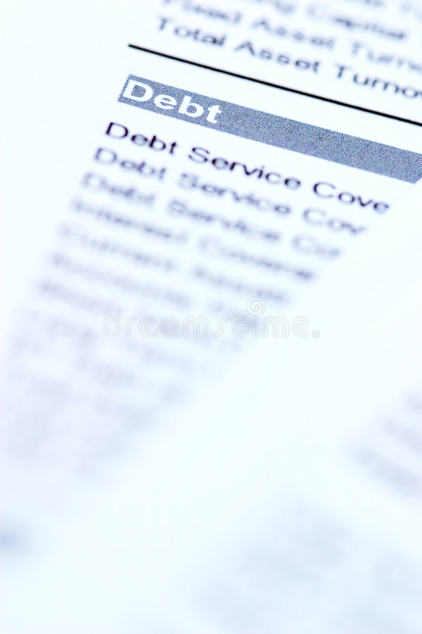 Debt. Financial documents with focus on the word debt stock photos
