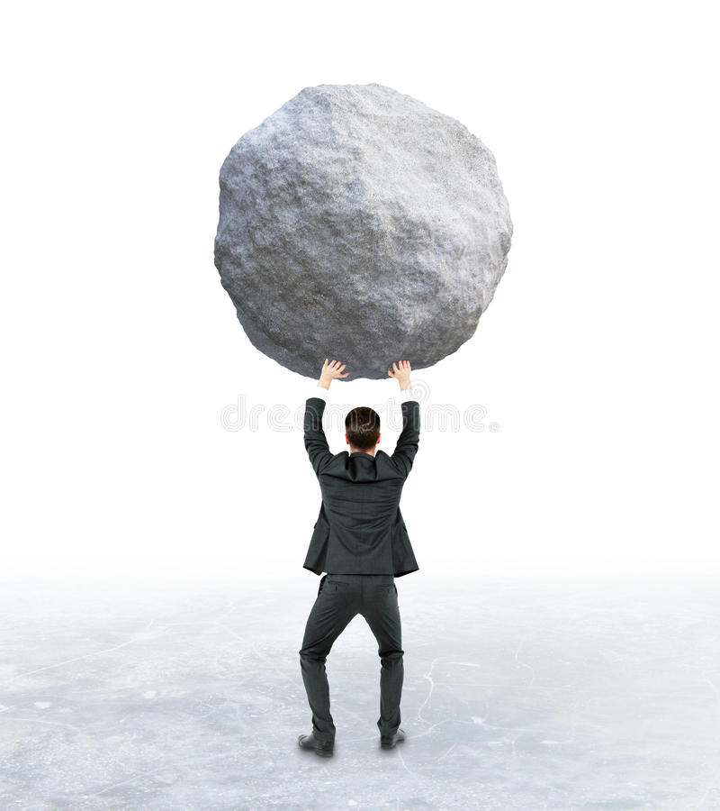 Debt concept. Back view of young businessman holding huge rock on abstract background. Debt concept stock image