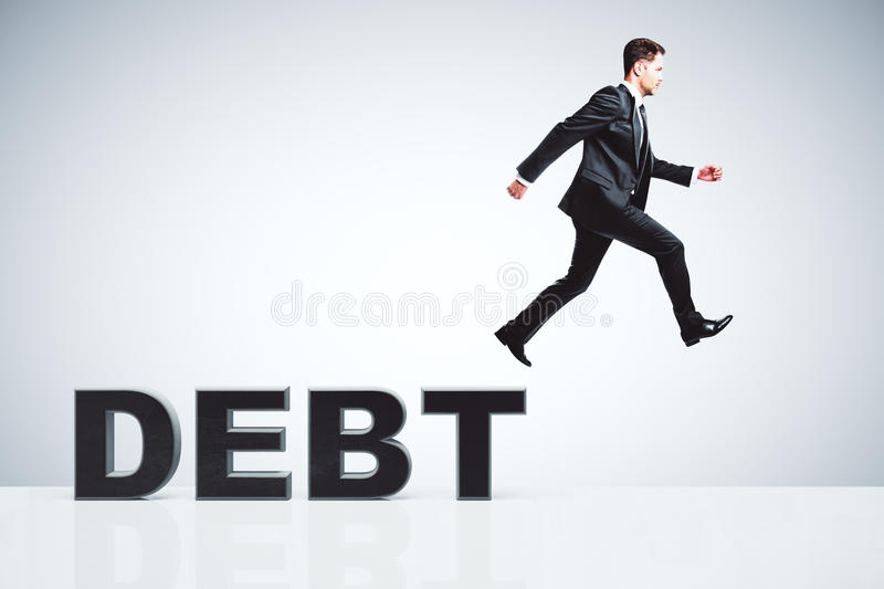 Debt concept with businessman escapes from debts royalty free stock photography