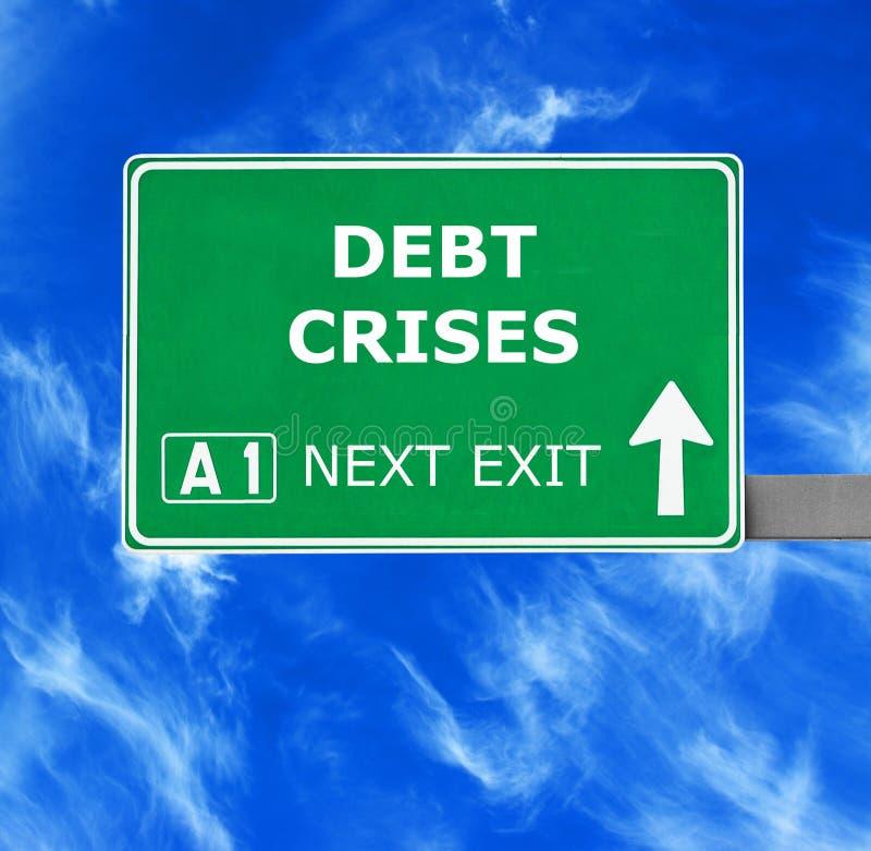 DEBT CRISES road sign against clear blue sky stock photos