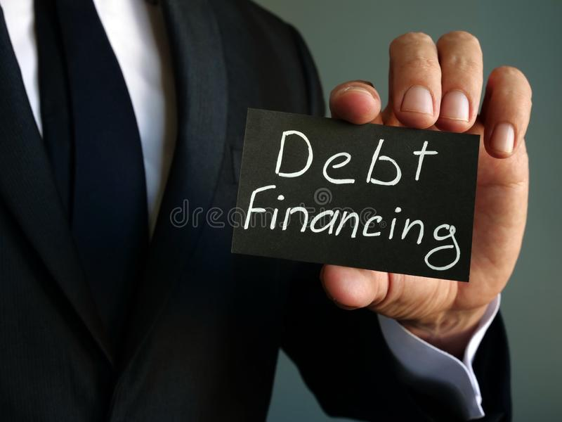 Debt financing sign in the  man hands royalty free stock image