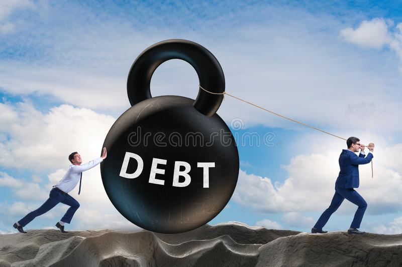Debt and loan concept with businessman pulling kettlebell. The debt and loan concept with businessman pulling kettlebell royalty free stock image