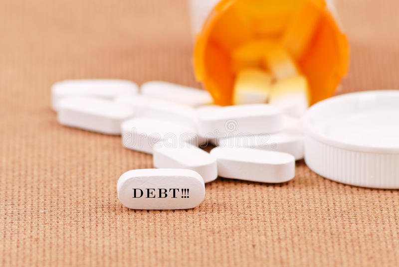 Debt Relief Pills. With Shallow DOF royalty free stock photo