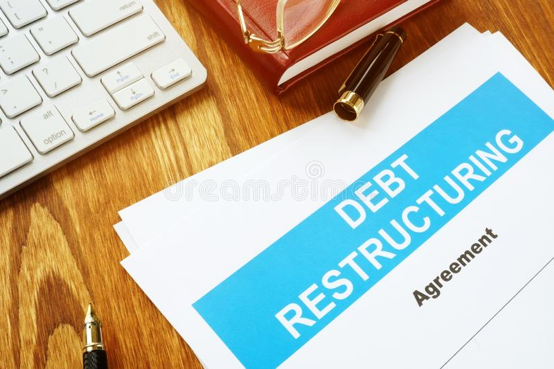 Debt restructuring Agreement DRA with keyboard. And pen stock images