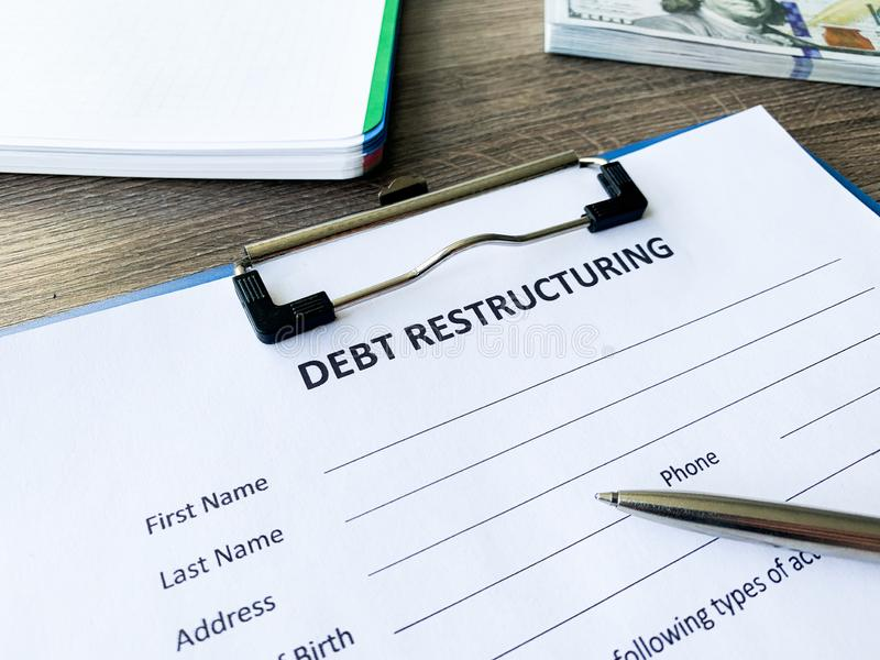 Debt restructuring document with graph on table. Debt restructuring document with graph on table stock photography