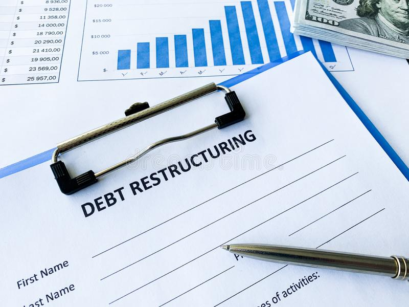 Debt restructuring document with graph on table. Debt restructuring document with graph on table royalty free stock photo
