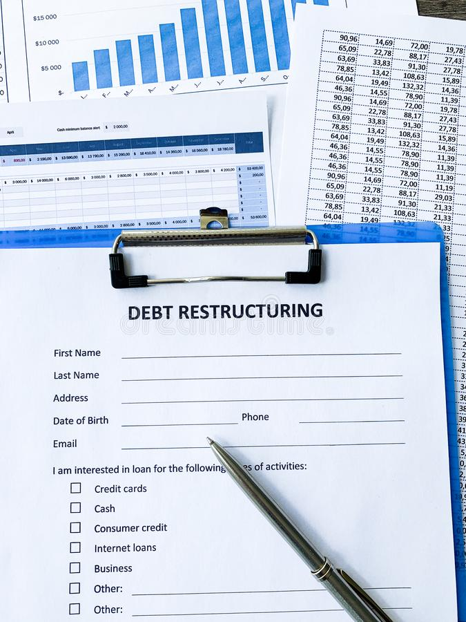 Debt restructuring document with graph on table. Debt restructuring document with graph on table royalty free stock photography