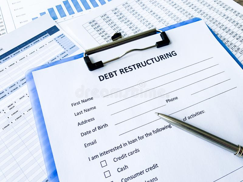 Debt restructuring document with graph on table. Debt restructuring document with graph on table stock photos