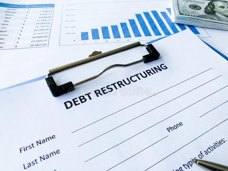 Debt restructuring document with graph on table. Debt restructuring document with graph on table royalty free stock image