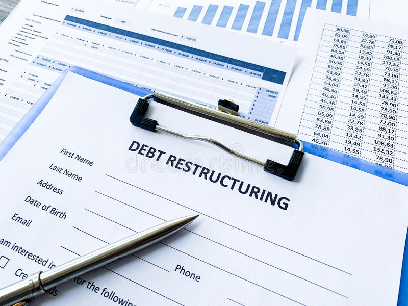 Debt restructuring document with graph on table. Debt restructuring document with graph on table stock image