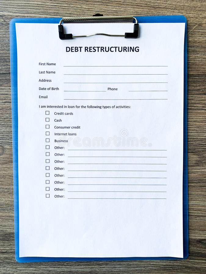 Debt restructuring document with graph on table. Debt restructuring document with graph on table royalty free stock photos