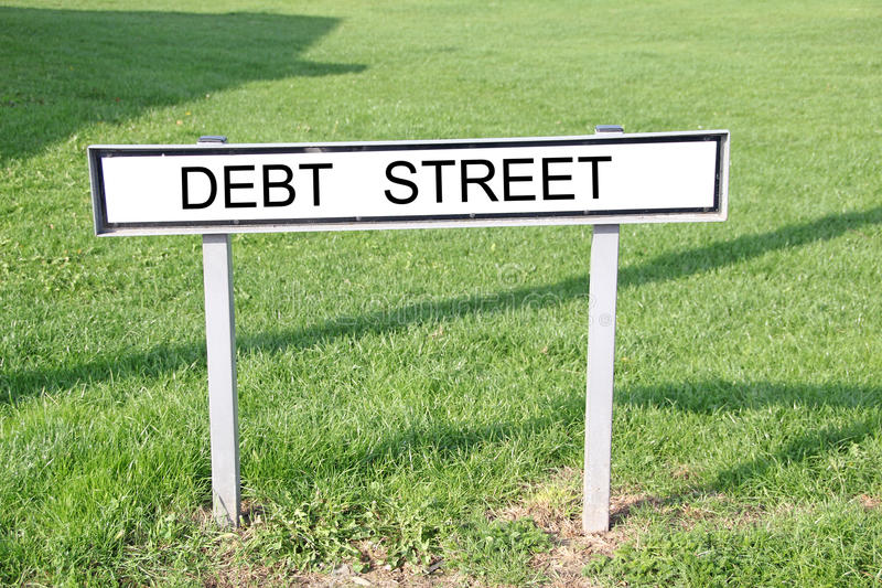 Debt street road sign. Photo of debt street road sign on grass verge royalty free stock photos