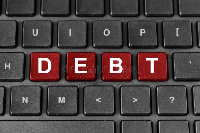 Debt word on keyboard royalty free stock photography