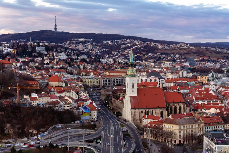 Dec 2011, Bratislava, Slovakia: aerial view of St. Martin cathedral and the old city at sunset royalty free stock images