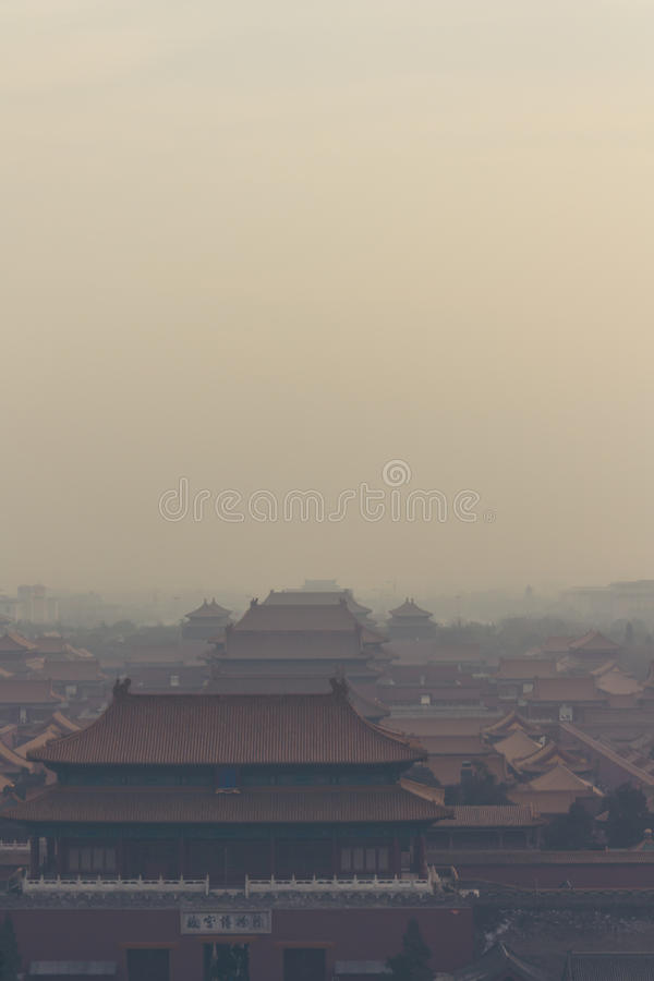 19,Dec,2015 China,Beijing :vertical shot of the Forbidden City in Beijing China, on a foggy day stock photos