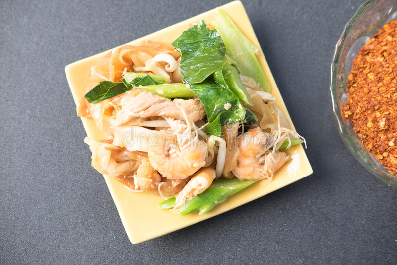 Decadent thai chicken and shrimp stir fry royalty free stock photo