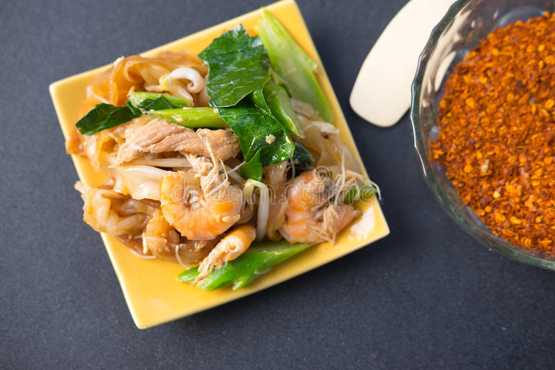 Decadent thai chicken stir fry pad see ew style. Decadent thai chicken and shrimp stir fry pad see ew style stock images