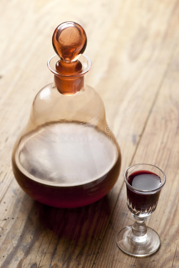 Decanter with glass of liqueur. royalty free stock photo