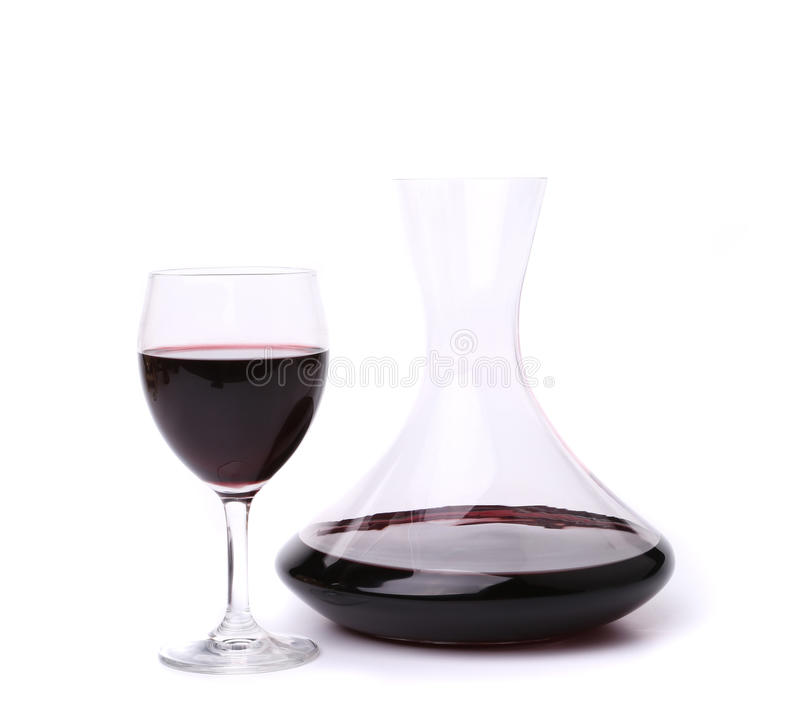 Decanter with red wine and glass stock images