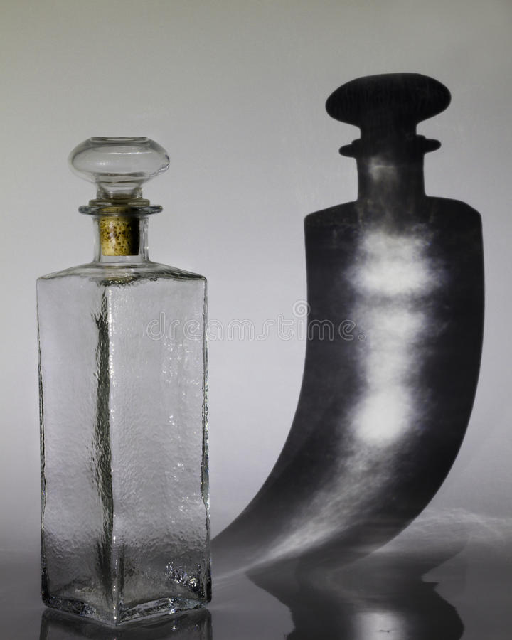 Decanter with shadow royalty free stock image