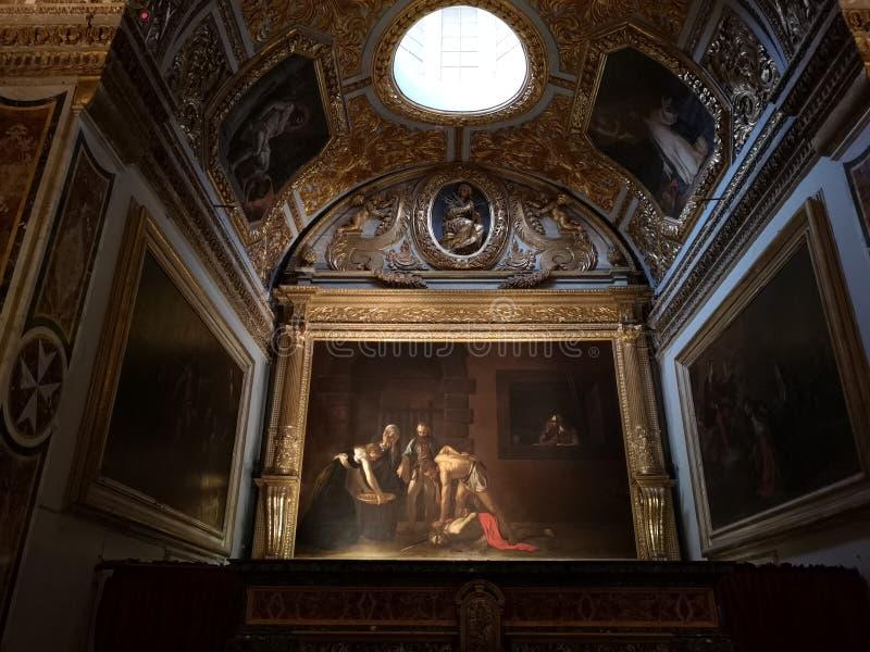 A decapitação de Saint John o batista por Caravaggio imagem de stock