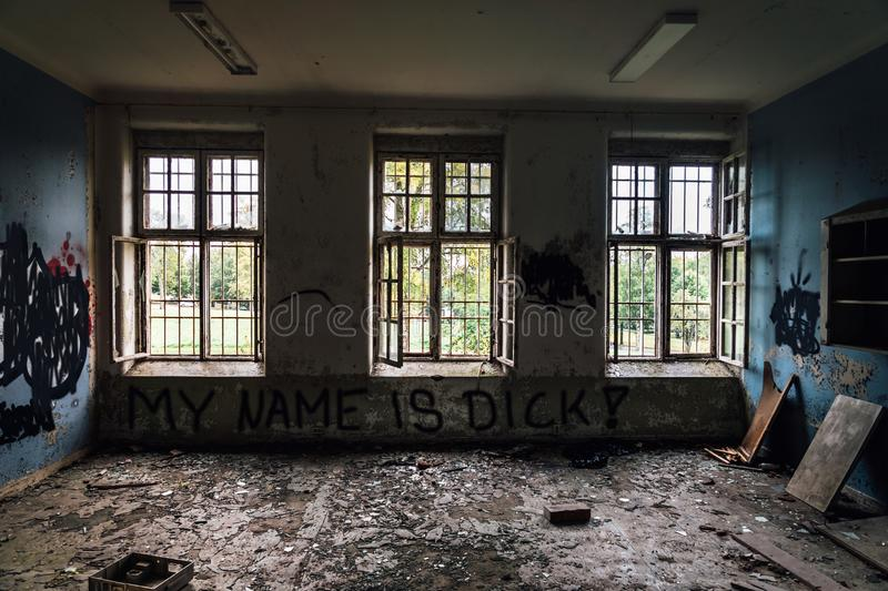 Decayed room from a closed down mental institution stock photography