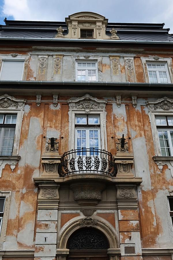 Decaying classicistic town house with typical balcony and windows, located in Esztergom, Hungary. Summer cloudy skies stock image