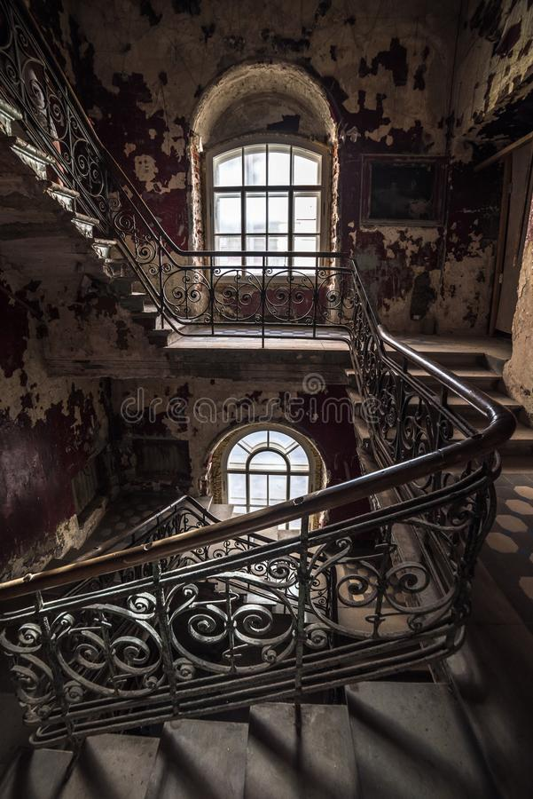 Decaying staircase in an abandoned house.  stock photos