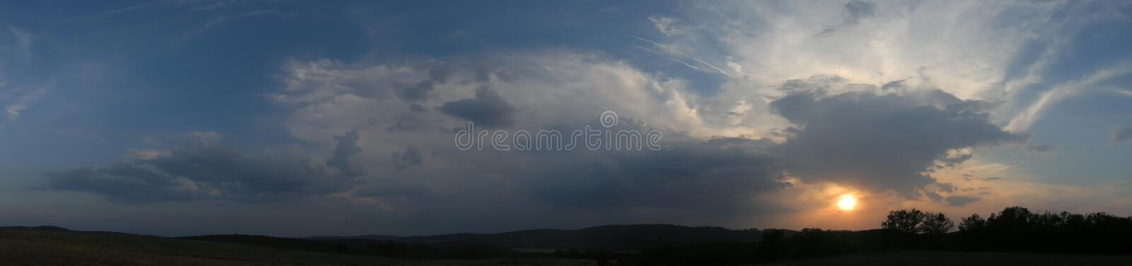 Decaying storm cloud during a sunset at summer evening stock photo