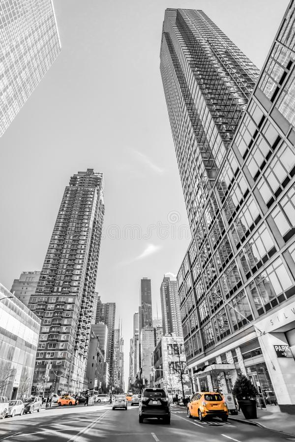 December, 2018: Black and White Buildings view in Downtown Manhattan. December, 2018: Black and White Huge Beautiful Buildings with Yellow Taxi in Downtown royalty free stock photography