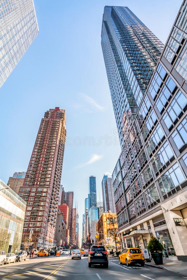December, 2018: Buildings view in Downtown Manhattan. December, 2018: Huge Beautiful Buildings view with Yellow Taxi in Downtown Manhattan royalty free stock images