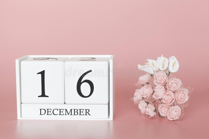 16 december dag 16 van maand Kalenderkubus op moderne roze achtergrond, concept zaken en een belangrijke gebeurtenis stock foto