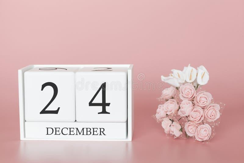 24 december Dag 24 van maand Kalenderkubus op moderne roze achtergrond, concept zaken en een belangrijke gebeurtenis stock afbeelding