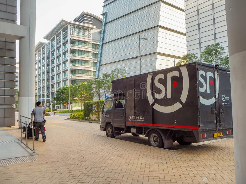 December 2018 - Hong Kong: Small truck and mail man from SF Express, China`s second largest express courier company based in. Shenzhen stock images