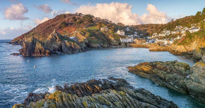 December Morning at the beautiful Polperro Harbour, Cornwall. Morning light in December over Polperro Harbour headland and entrance, Cornwall royalty free stock image