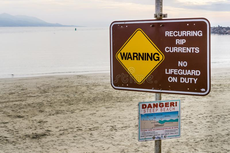 December 24, 2017 Morro Bay / CA / USA - Warning Recurring RIP currents No Lifeguard on Duty posted sign together with other. Recommendations royalty free stock photos