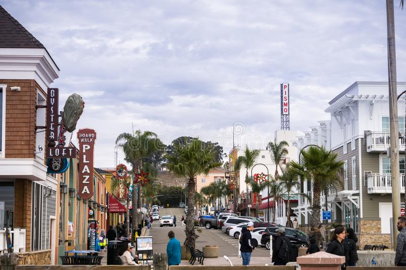 December 24, 2017 Pismo Beach / CA / USA - Street with restaurants and bars leading to the town`s pier stock images