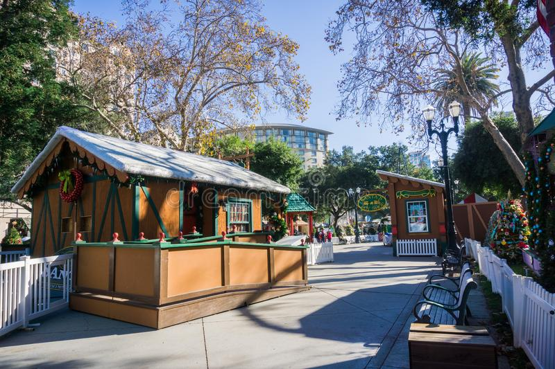 December 6, 2017 San Jose / CA / USA - Alley and exhibits at 'Christmas in the park ' event in Plaza de Cesar Chavez, Silicon. Valley, south San Francisco bay royalty free stock photography